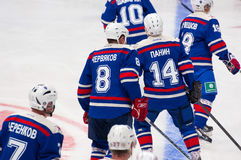 Players of SKA team ready to start the game. RUSSIA, MOSCOW - APRIL 27, 2015: Unidentified players of SKA team just before game CSKA vs SKA teams on Hockey Cup Stock Photos