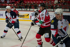 Players Slovan (Bratislava) and the Donbass (Donetsk) fight for the puck Stock Photos