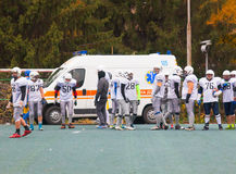 Players standing near the ambulance Stock Photography