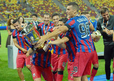 Players of Steaua Bucharest fighting for trophy Stock Photo