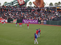 Players taking balls in the outfield Stock Photo