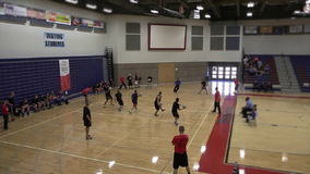 Players throwing dodge balls stock video