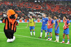 Players watch the opponent's mascot Royalty Free Stock Photo