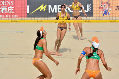 Players in women's beach volleyball. A women's FIVB World Tour game in progress, Beach volleyball is a game which has achieved worldwide popularity. Photo taken Royalty Free Stock Photography