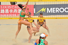 Players in women's beach volleyball. A women's FIVB World Tour game in progress, Beach volleyball is a game which has achieved worldwide popularity. Photo taken Stock Images