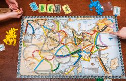 Playfield of Ticket to Ride: Europe board game. MOSCOW, RUSSIA - JUNE 5, 2019: people play in Ticket to Ride: Europe board game. This game was designed by Alan R stock images