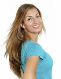 Playful. An attractive young woman playfully turns towards the camera Royalty Free Stock Photo