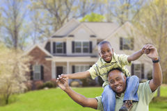Playful African American Father and Son In Front of Home Royalty Free Stock Image