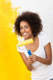Playful African American woman painting Stock Photos