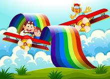 Playful animals near the rainbow above the hills Stock Photography
