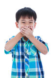 Playful asian boy covering his mouth. Isolated on white backgrou Royalty Free Stock Photos