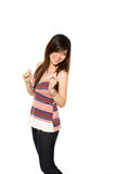 Playful asian girl in casual clothes. Playful asian girl in casual t-shirt and jeans with a beautiful smile Stock Images