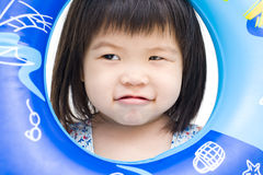 Playful asian girl with swimming float Royalty Free Stock Photos