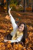 Playful autumn woman. Stock Image