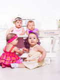 Babies group in festive clothing. Playful babies group in festive clothing Royalty Free Stock Image