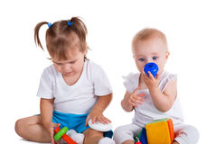 Playful babies playing with toys Royalty Free Stock Photos