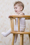 Playful Baby Boy Sitting On High Chair Royalty Free Stock Photo