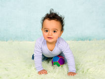 Playful baby crawling Royalty Free Stock Photography