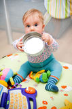 Playful baby girl. In a playpen royalty free stock images
