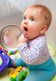 Playful baby girl. In a playpen Stock Images