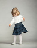 Playful baby girl  dancing Stock Photo