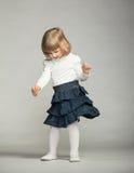 Playful baby girl  dancing Stock Photo