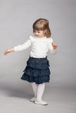 Playful baby girl dancing Stock Images