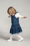 Playful baby girl dancing Royalty Free Stock Photos