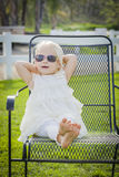 Playful Baby Girl Wearing Sunglasses Outside at Park Royalty Free Stock Image