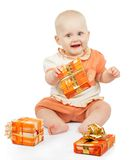 Playful baby keeps festive gift Stock Photo