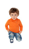 Playful baby on knees with orange jersey Stock Photos