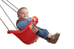 Playful baby in a swing royalty free stock photography