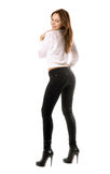 Playful beautiful girl in black tight jeans royalty free stock photos