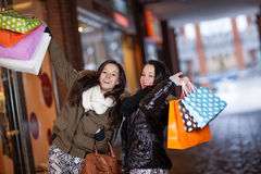 Playful shoppers with lots of purchases Royalty Free Stock Photos