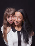 Playful beautiful young mother and her teenage daughter Stock Photography