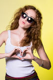 Playful beautiful young woman with sunglasses Royalty Free Stock Photos