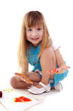 Playful beauty girl with many-coloured hands. Small playful beauty girl with many-coloured hands and painted home on white background stock photo