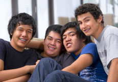Playful behaviour of male students Stock Photo