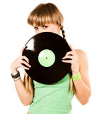 Playful blond girl with vinyl records Royalty Free Stock Photo