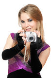 Playful blonde holding a photo camera. Isolated Stock Photos