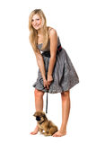 Playful blonde with puppy Royalty Free Stock Photography