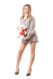 Playful blonde with teddy bear Stock Image