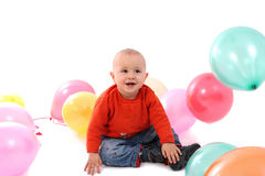Playful boy with balloons Stock Image