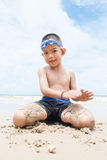 Playful boy on the beach with sea  on background. Stock Photos