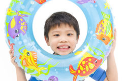 Playful boy with swimming float Royalty Free Stock Photography