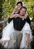 Playful Bride and Groom piggyback Stock Photos