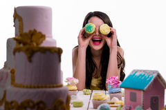 Playful brunette with her bakery riches Stock Photography