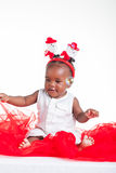 Playful with the bublles. A 8 month old baby dressed to explore Christmas Royalty Free Stock Photos