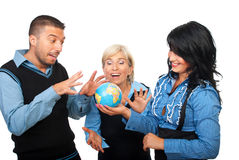 Playful business people with globe. Three business people team having fun and laughing around a world globe isolated on white background,check also royalty free stock images