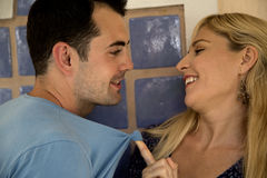 Playful caucasian couple showing who is in control Royalty Free Stock Photo